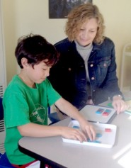 Lise Narath teaching a child to read